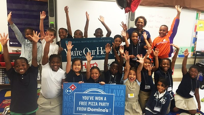 Tuckaseegee Elementary teacher Shirley Hamilton with students after being awarded the Hometown Hero Appreciation Award.